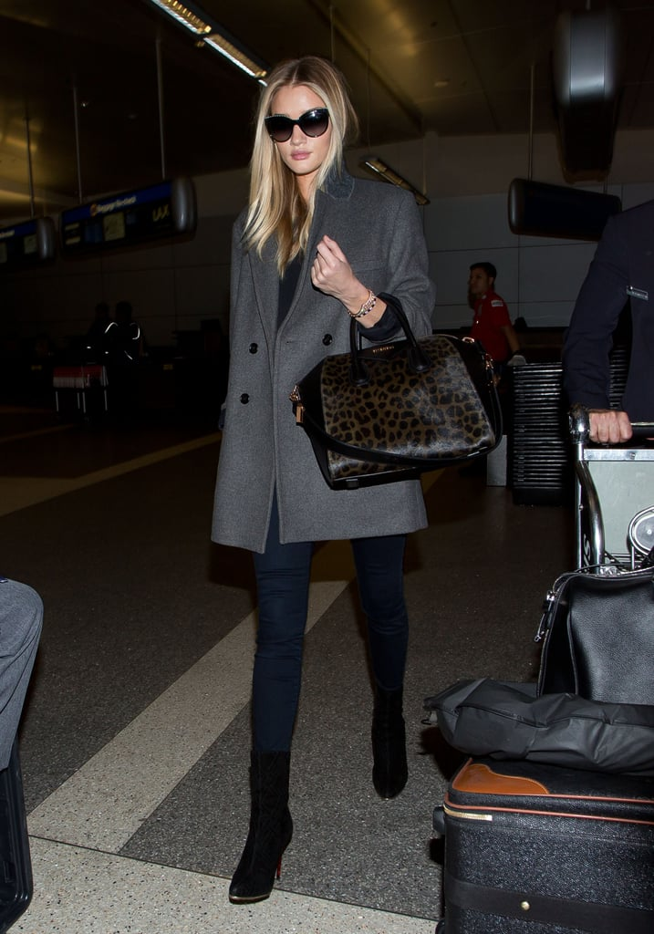Our absolute favorite part of Rosie Huntington-Whiteley's travel outfit? That gorgeous leopard Givenchy bag!
