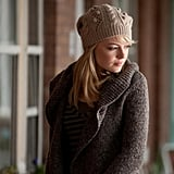 Cozy in a knit beanie and wrap cardigan.
