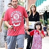 Adam Sandler held daughter Sunny's hand after leaving a restaurant on Saturday in LA.