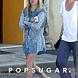 Sienna Miller stuck to her signature bohemian style in a blue printed dress and beaded t-strap sandals.