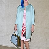 Katy Perry made her way into Miu Miu — with hair to match her bag and coat.
