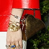 Rita Ora's accessories proved eclectic, right down to her gold metallic purse.