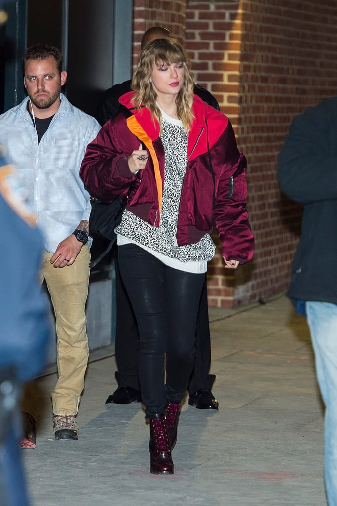 Taylor styled a pair of heeled combat boots with an oversize burgundy bomber jacket by Unravel. She finished her look off with a cheetah-print top and black pants.