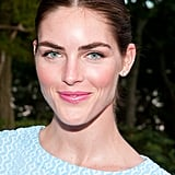 Model Hilary Rhoda proved that being the spokesperson for Estee Lauder has paid off! Look at her glowing skin and soft pink makeup. Her simple ponytail and feminine makeup are perfect for a weekend brunch.