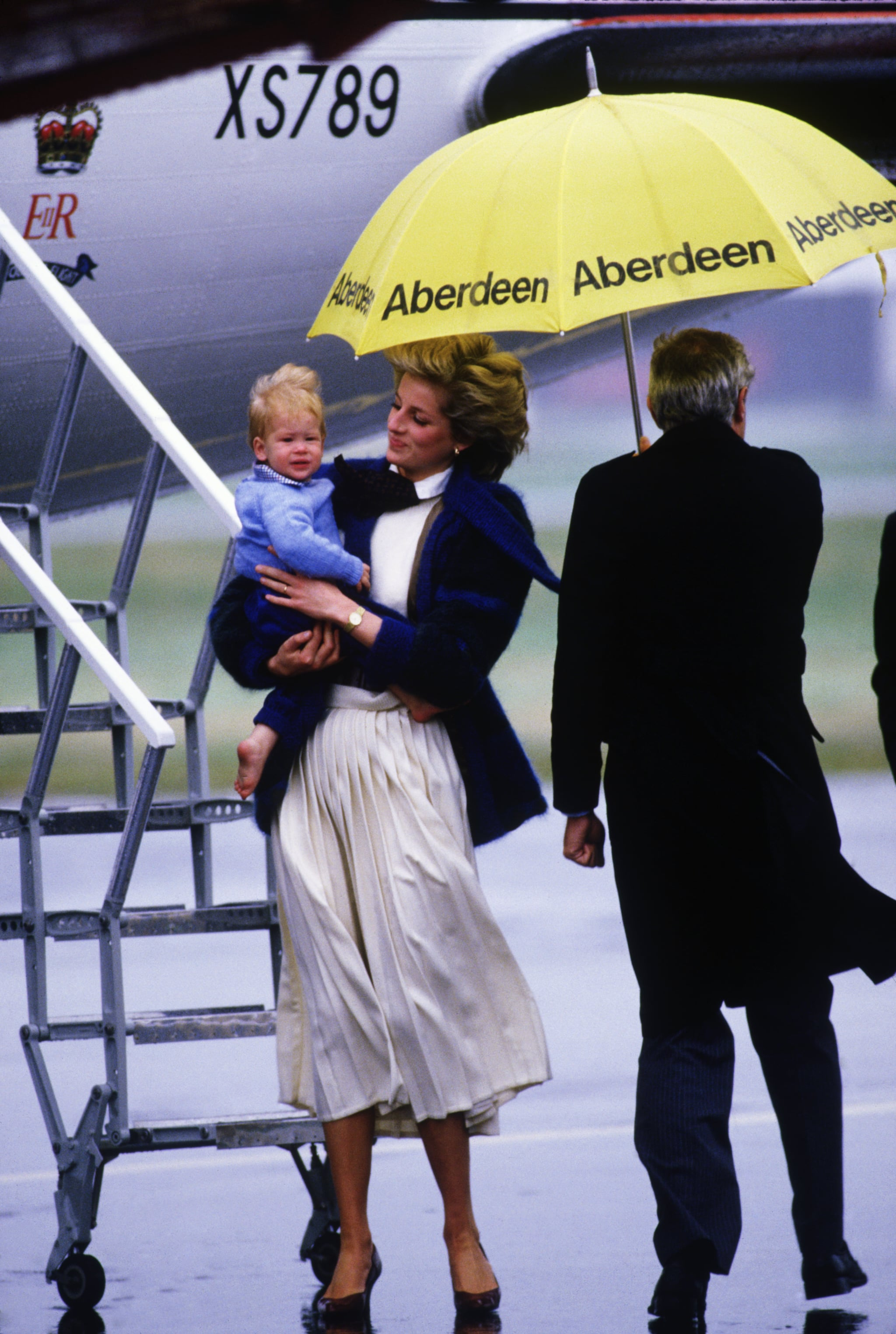 Princess Diana carried Prince Harry while leaving Aberdeen, Scotland, in September 1985.