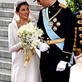 In 1998 when she was 26 she married teacher Alfonso Guerrero, which caused controversy when she got engaged to Prince Felipe. However, because her first marriage was a civil ceremony, it didn't require an annulment and she was therefore permitted to have a Roman Catholic wedding to her prince. She has had four names: Miss Doña Letizia Ortiz Rocasolano, Mrs. Doña Letizia Ortiz Rocasolano de Guerrero, Her Royal Highness The Princess of Asturias and Her Majesty Queen Letizia of Spain. Before she married into the royal family, she was an accomplished journalist, following her father into the profession, and gaining a masters in broadcast journalism in Madrid. She started out her career on daily newspaper La Nueva España before moving into TV, where she progressed from Bloomberg to CNN+, and then the national network Television Española, where she became the anchor on its flagship show. She shares her birthday (Sept. 15) with Prince Harry, although she is 12 years older. She is the granddaughter of a taxi driver and had a close relationship with her grandparents — living with them in Madrid when she was studying and vacationing with them in Alicante when they retired there.