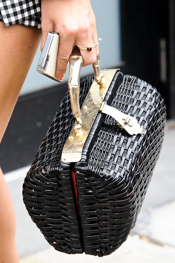 That's not a picnic basket — it's one very chic way to tote your stuff.
