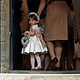The little princess gave photographers one last glance before walking down the aisle at Pippa's wedding to James Matthews in May.