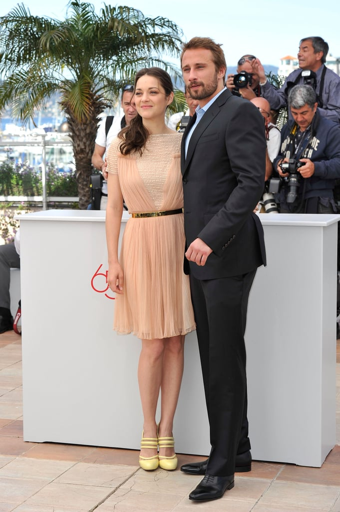 Marion Cotillard stood beside her handsome costar Matthias Schoenaerts at the press conference and photocall for De Rouille et d'Os (Rust and Bone) at the Cannes Film Festival in Cannes, France, today. Marion actually filmed the movie, which has her playing a whale trainer, nearby in France. We saw Marion stripped down for intense water scenes for the movie back when they shot it last Fall. Cannes is just the first stop on a crazy Summer ahead for Marion as she promotes The Dark Knight Rises. That promotional tour will kick into high gear soon, but for now she's focusing on this project in the glamorous location. Don't miss our updates from the festival, starting with all the pictures from day one of Cannes!