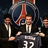 David Beckham held up his Paris St. Germain jersey at a press event.
