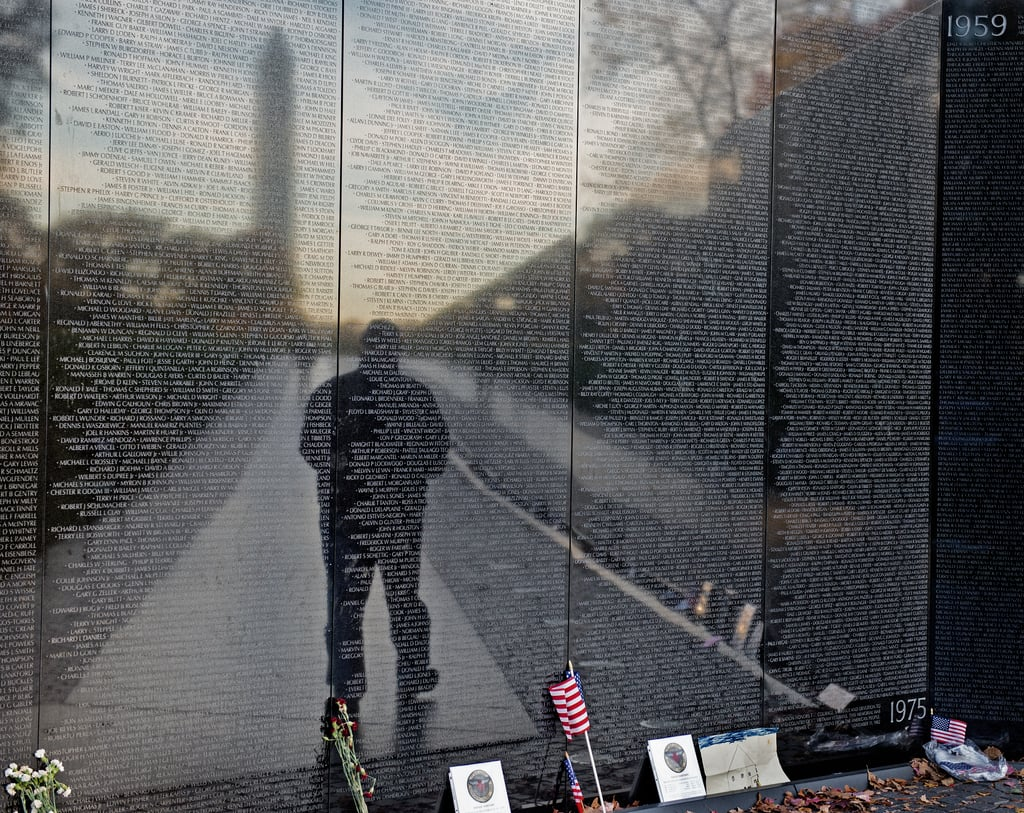 A man paid tribute to veterans, visiting the Vietnam Veterans Memorial in Washington DC on Veterans Day.