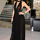 Doutzen Kroes opted for a low-cut black Swiss-dot gown and gold jewelry at this year's CFDA Fashion Awards in NYC.