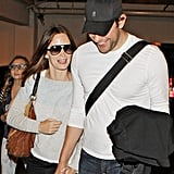Emily Blunt and John Krasinski hold hands.