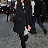Katie Holmes didn't let the chilly weather stop her from looking stylish in an ivory lace dress and Pretty Polly tights topped with a black military coat with gold buttons.