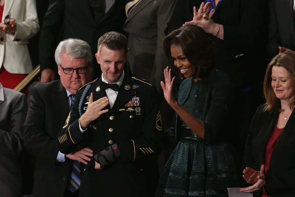 Michelle waved as she waited for her husband's speech.