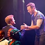 Prince Harry greeted Chris Martin at a June charity concert in London.