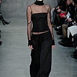 The Vera Wang turtleneck debuted on the Fall 2015 runway over a tight black bustier and complete with slouchy trousers, just like Rita Ora's.