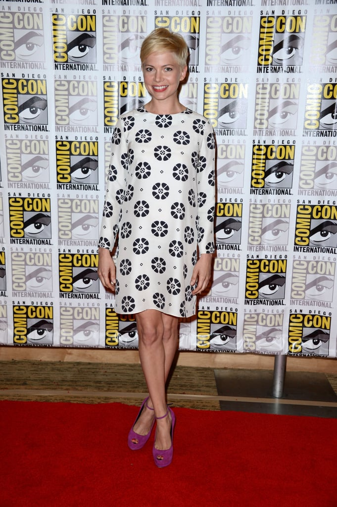 Pulling that cute-as-a-button trick again, Michelle Williams looked so-chic at Comic-Con. A wallpaper print shift and contrasting purple pumps made for an adorable duo.