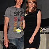Cute couple Andrew Garfield and Emma Stone stayed close during the 2011 Comic-Con panel for The Amazing Spider-Man.