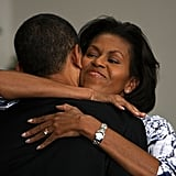 Michelle gave Barack a big hug in Oregon.