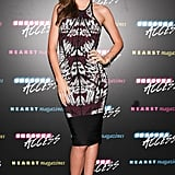 Miranda Kerr's curves were not to be missed in a printed Hervé Léger by Max Azria sheath.