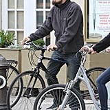 Leonardo DiCaprio wore a straw hat during a bike ride through NYC.