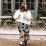 A White Sweater, an Animal-Print Midi Skirt, and Black Boots