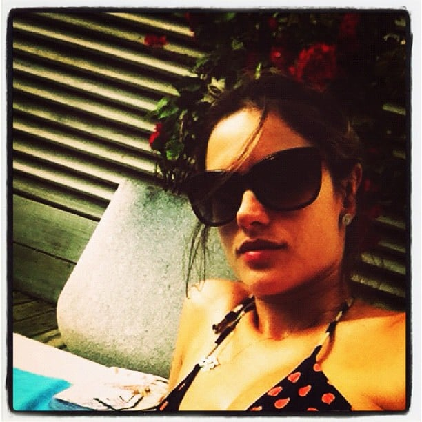 Alessandra Ambrosio lounged by the pool over the holiday weekend.  Source: Instagram user alecambrosio