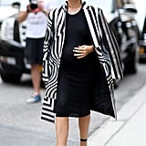 There's nothing that looks quite as good with a black dress as a bold, black-and-white graphic coat.