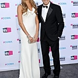 Stacy Keibler went white by George Clooney's side at the Critics' Choice Awards in January 2012.