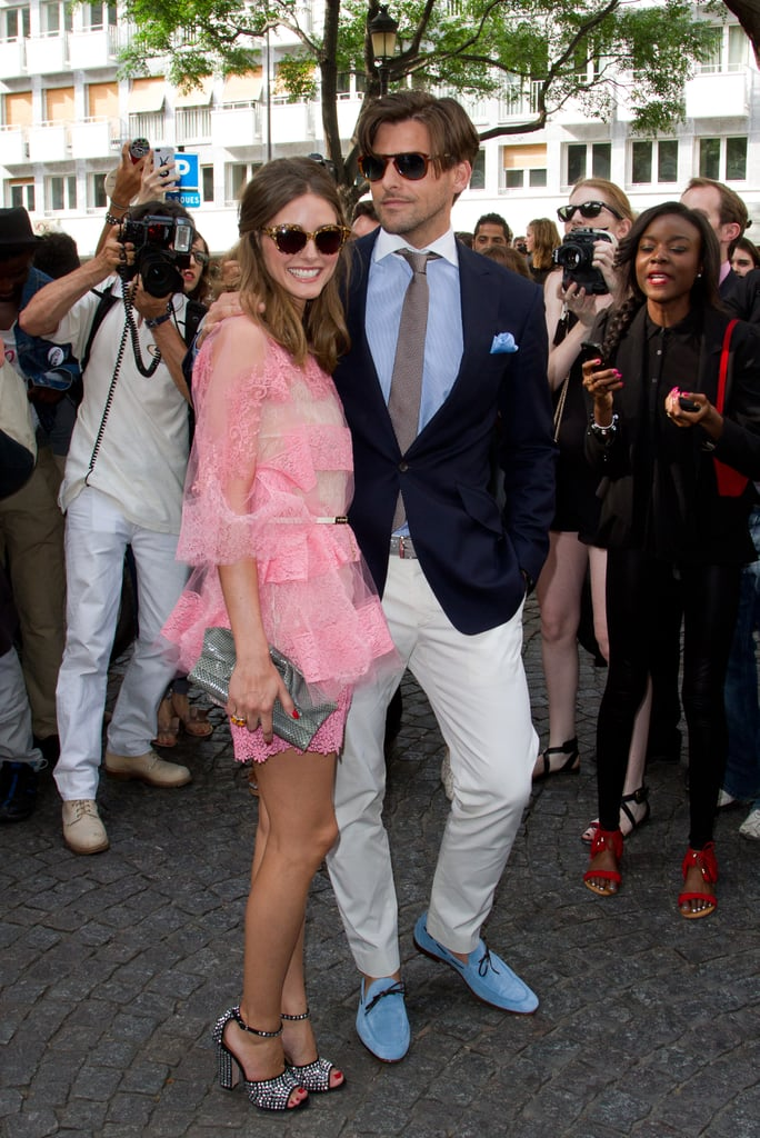 Olivia and her beau were picture-perfect as they arrived at Valentino. While we're smitten with Olivia's pretty, lace Valentino, we have to give Johannes props for his own dapper look.