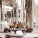 Sparkly deer and twinkle lights make this Winter wedding table unique.