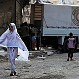 A young girl walks from an aid truck in a rebel-held town near Damascus.