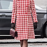 While in Norway on Jan. 2018, Kate kept warm in a houndstooth print Catherine Walker coat. She accessorized with a pair of fringed heels from Tod's, a Chanel bag, and a pair of pearl earrings by the Swedish brand In2Design.