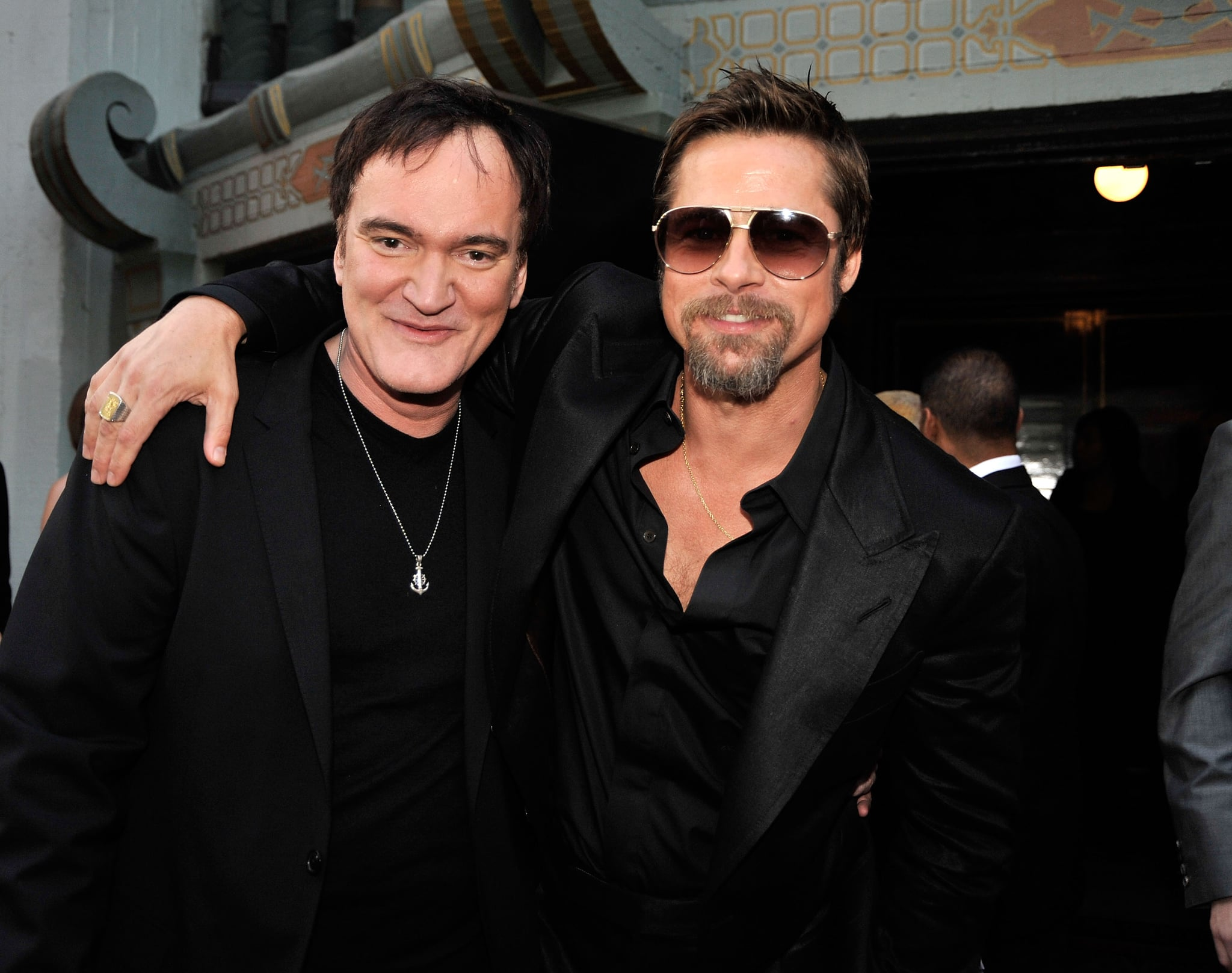 HOLLYWOOD - AUGUST 10:  (L-R) Director Quentin Tarantino and actor Brad Pitt arrive at the premiere of Weinstein Co.'s