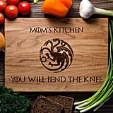 Bend the Knee Cutting Board