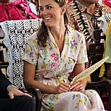 Project D in Tuvalu: As the tour came to a close, Kate bowed out in island style with a pretty floral dress and pale blue and gold Azuni earrings.