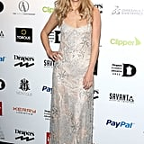 Suki eschewed edgy for pretty in a simple slip with delicate embroidery at the Drapers Fashion Awards in November 2012.