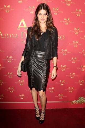 Model Isabeli Fontana struck a sultry note in lace-up heels and a tough leather pencil skirt at the Anna Dello Russo for H&M party. Source: H&M