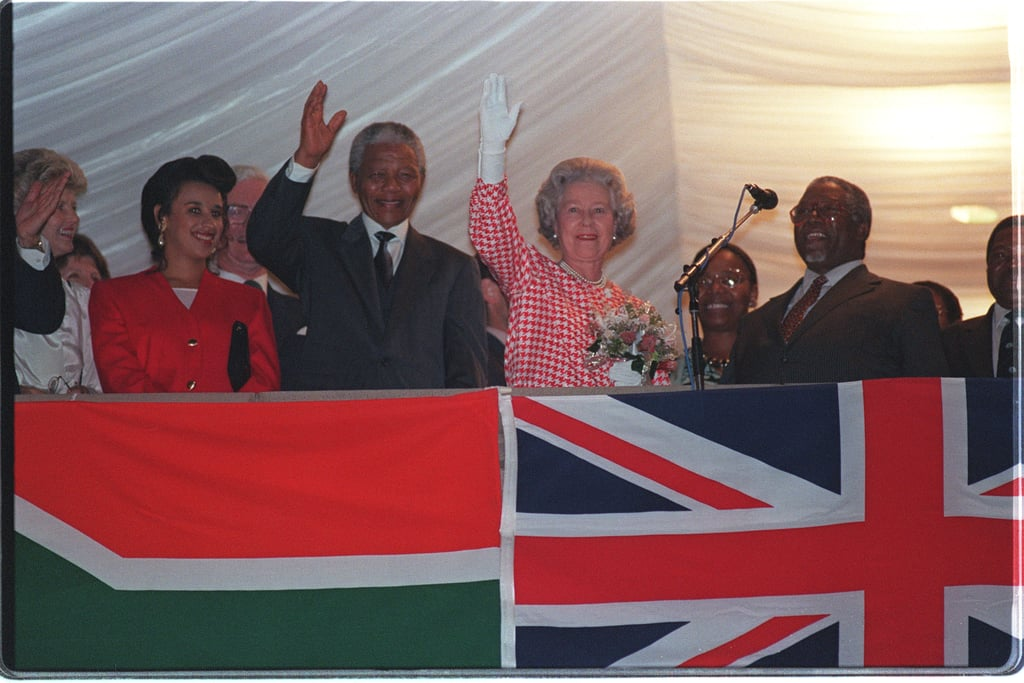 Celebrating South Africa's reentry to the commonwealth following the end of apartheid with Nelson Mandela in 1995.
