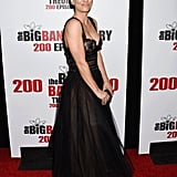 She showed off her silver ring and black clutch.