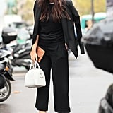 A tomboy news cap and statement heels made this all-black look anything but basic.