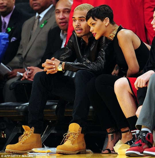 Rihanna jets back to be with Chris Brown at Christmas basketball match between the LA Lakers and the New York Knicks.