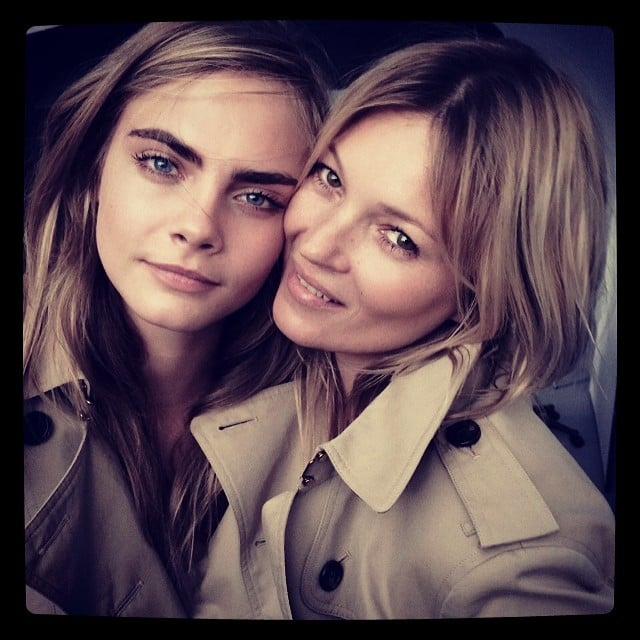 Cara Delevingne and Kate Moss wore matching Burberry coats while shooting photos for an upcoming fragrance campaign. Source: Instagram user mariotestino