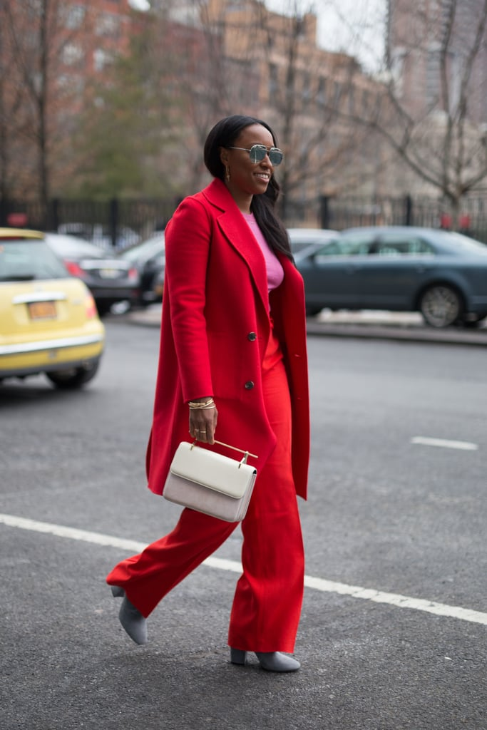 A Bold Suit, Bright Top, and White-Hot Bag