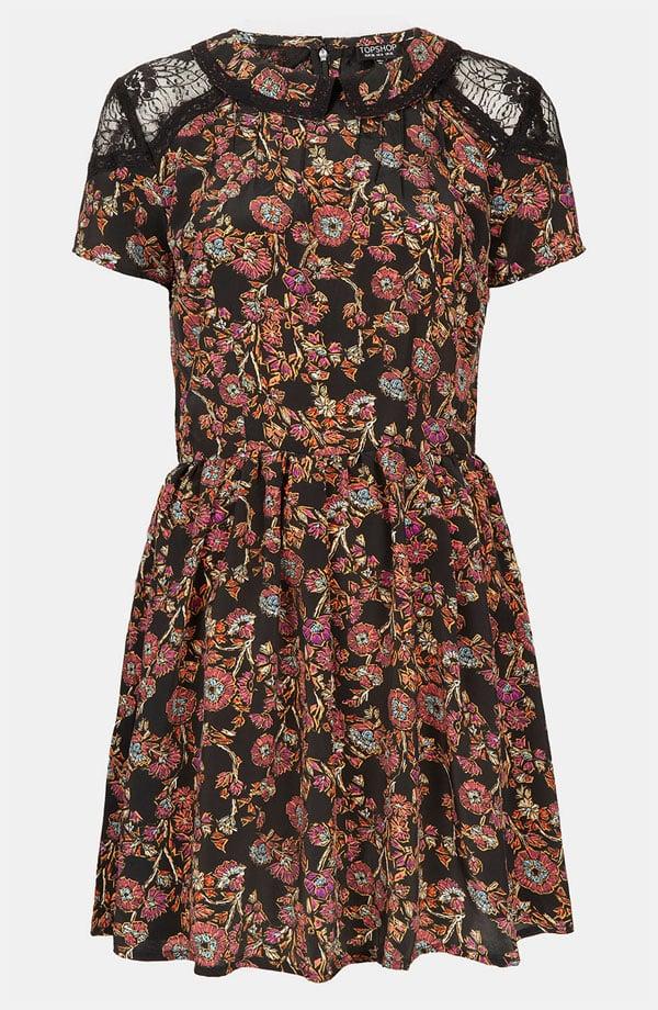 "Add black tights and booties (maybe top with your leather jacket), and this sweet Topshop ""Sketch"" Floral Lace Dress ($76) gets a cooler makeover for a dinner and a movie date."
