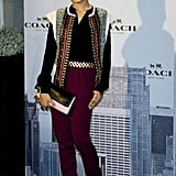 The only thing richer than Freida Pinto's aubergine trousers at the Madrid Coach boutique was her ornately embellished jacket.