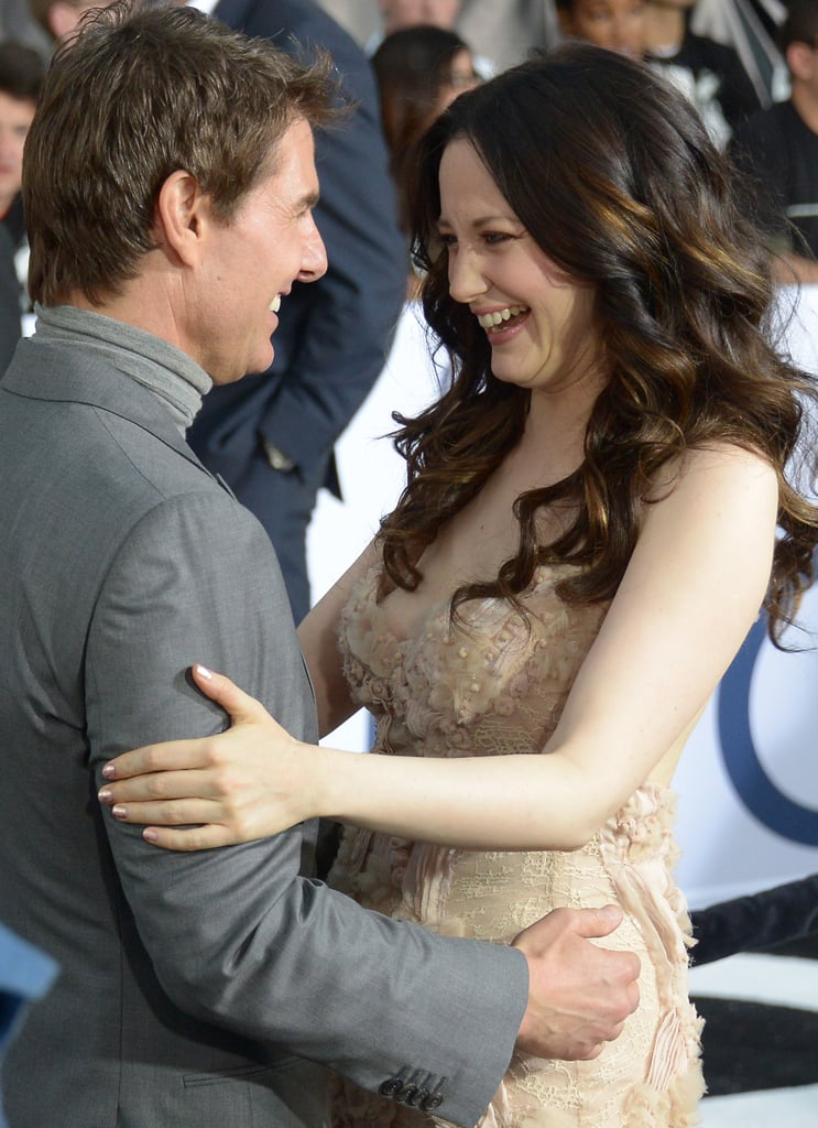 Tom Cruise and Andrea Riseborough embraced at the Oblivion premiere in Hollywood.