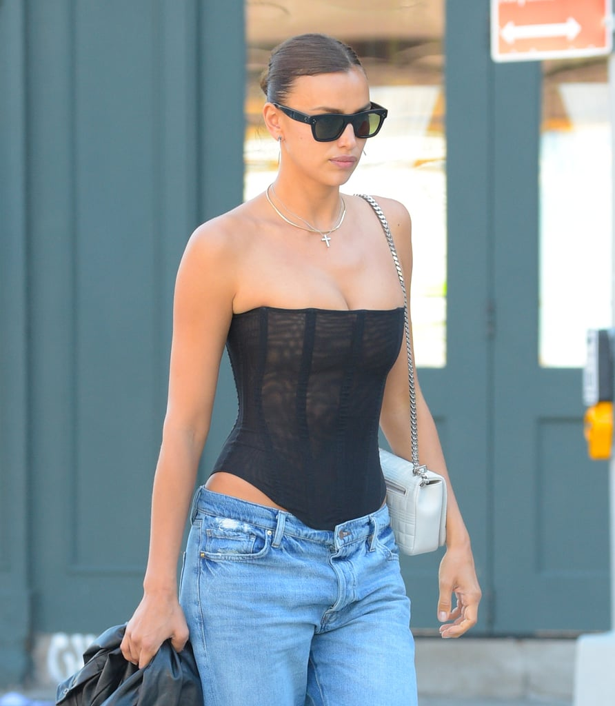 """As the very wise Sophie Turner once said, low-rise jeans are """"kind of offensive,"""" and I couldn't agree more. However, I will say, Irina Shayk's recent take on the nostalgic trend has my attention. In an outfit that looked straight from the 2000s, the model rocked a pair of extremely low-rise jeans and a sheer black corset top from Are You Am I, creating a look so simple, yet so impactful. Irina, who recently returned from a trip to France with Kanye West, was spotted walking around New York City in said outfit, with her 4-year-old daughter Lea in tow. She accessorized with Both boots, classic black shades, plain silver jewelry, and a white Burberry purse, and later in the day, added an oversized leather jacket. While Irina's denim is a little too low for my taste, you have to admit she put together a pretty perfect outfit that might even have you reconsidering your stance on the trend. Ahead, admire the look from all angles.      Related:                                                                                                           From Exposed Bras to Combat Boots, Irina Shayk Knows How to Make an Outfit Sexy"""