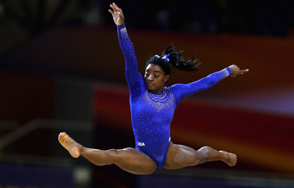 """Simone Biles is a champion, no question about it. The 21-year-old Olympic gymnast has conquered many incredible feats, and sometimes she's so casual about it, we almost forget how unbelievable her accomplishments are. Well, Simone's recent performance at the World Gymnastics Championships in Qatar, after a trip to the ER, was a reality check for all of us — she really is one of the greatest of all time.  After a CT scan revealed a kidney stone (or as Simone calls it, """"the Doha pearl""""), she decided to leave the hospital to continue on in the competition. Simone was not allowed the typical pain medication, because of its effects on a drug test, so she battled through pain in order to secure the highest scores on floor exercise, uneven bars, and vault, and put Team USA in the lead. She'll likely secure spots in all four final rounds, an accomplishment that hasn't been matched since she competed in 2013. Ahead, see snaps of Simone's exceptional routine that resulted in the top all-round qualifying score.      Related:                                                                                                           This Is the Meaning Behind the Teal Leotard Simone Biles Wore at the US Championships"""